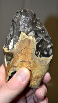 A nicely worked Upper Paleolithic (Mousterian / Neanderthal) flint hand axe found near London. SOLD